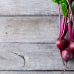 red beet natural color colour source on wood background